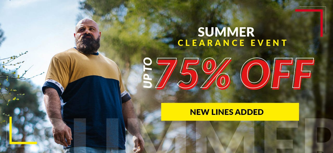 Strongman Laurence Shahlaei standing in a forest. Text overlay reads: Summer clearance event, up to 75% off, new lines added